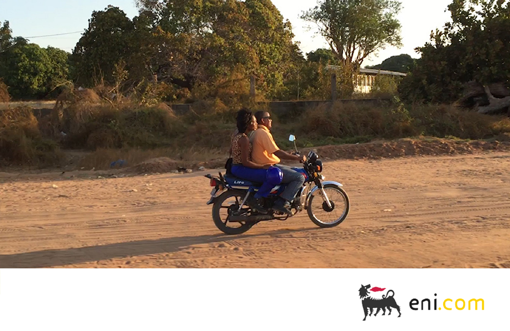 A couple on a motorcycle in Mozambique. Moving forward: powering Mozambique