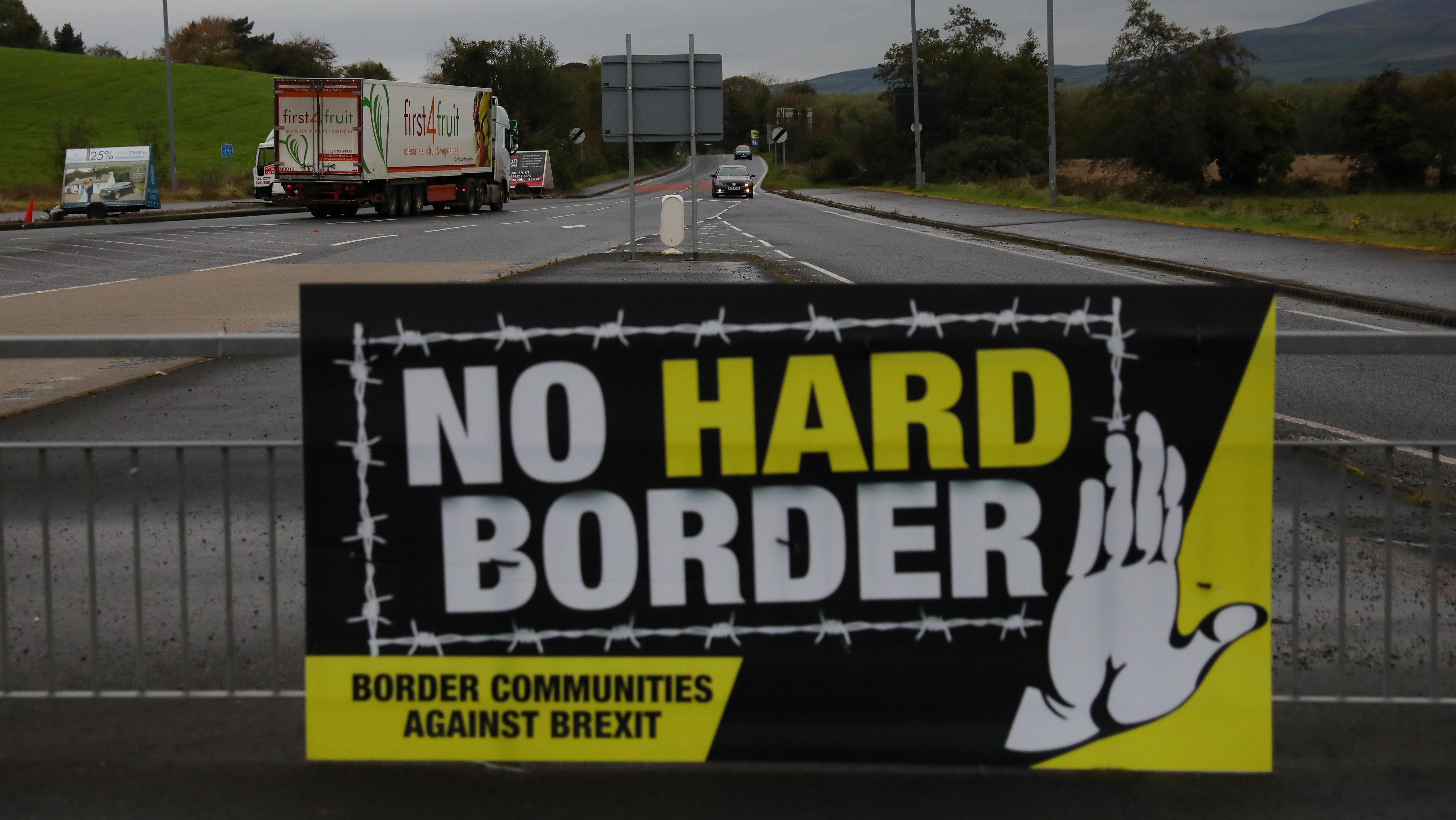 A lorry drives past a 'No Hard Border' poster near Londonderry, Northern Ireland October 15, 2019