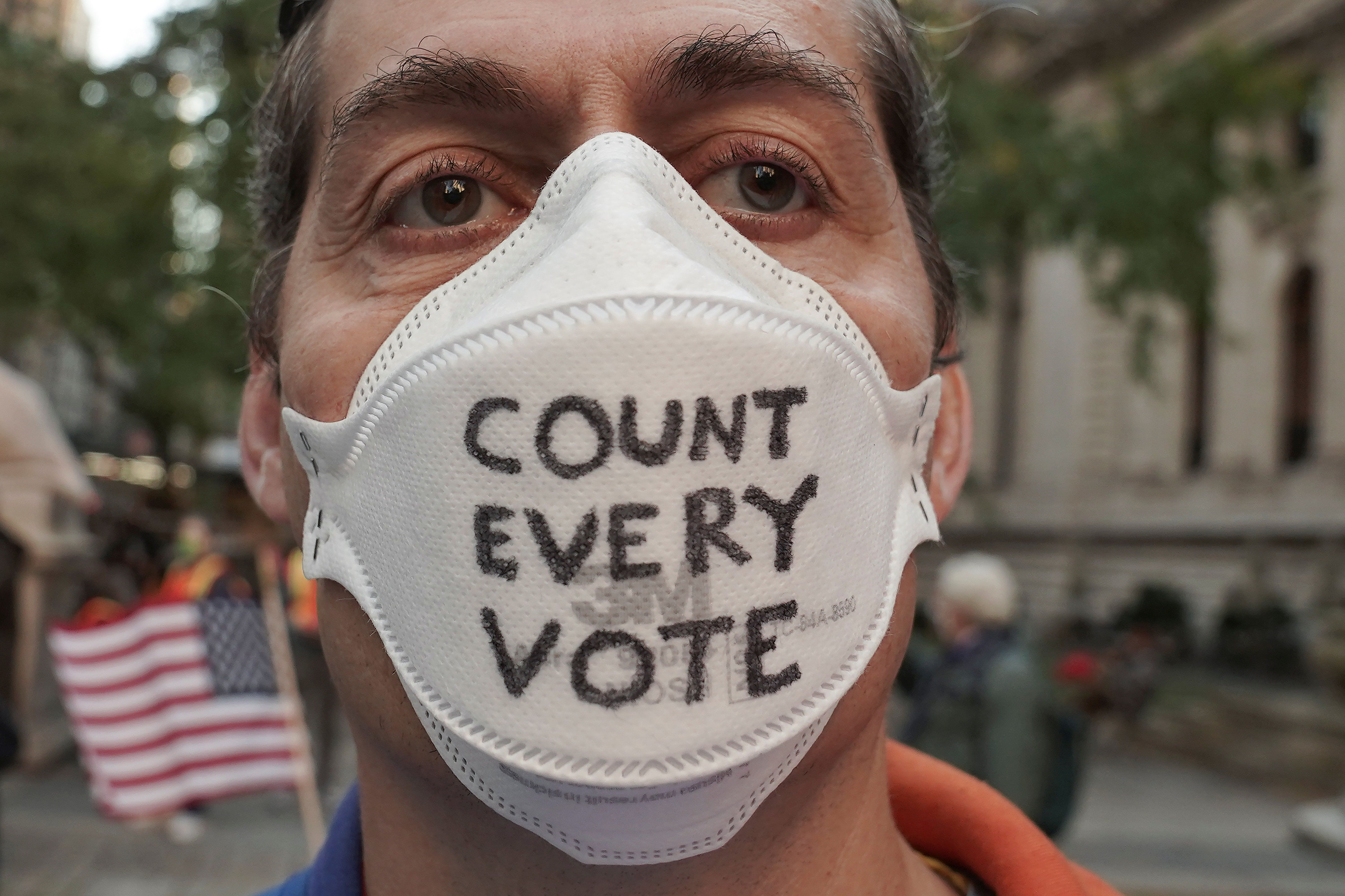 """A man attends a """"Count Every Vote"""" rally the day after the US election in New York City. Reuters"""