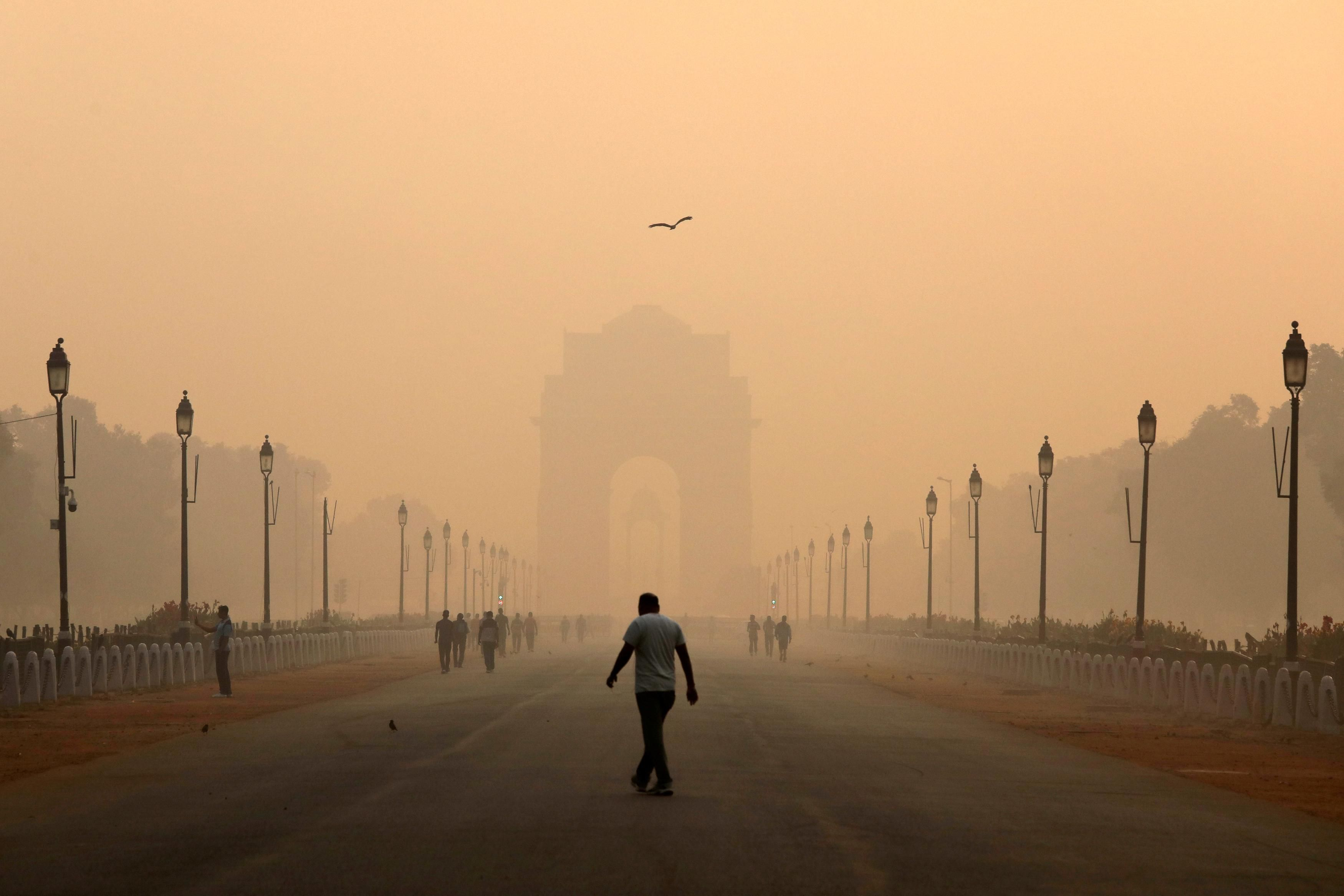 A man walks in front of the India Gate shrouded in smog in New Delhi. Reuters