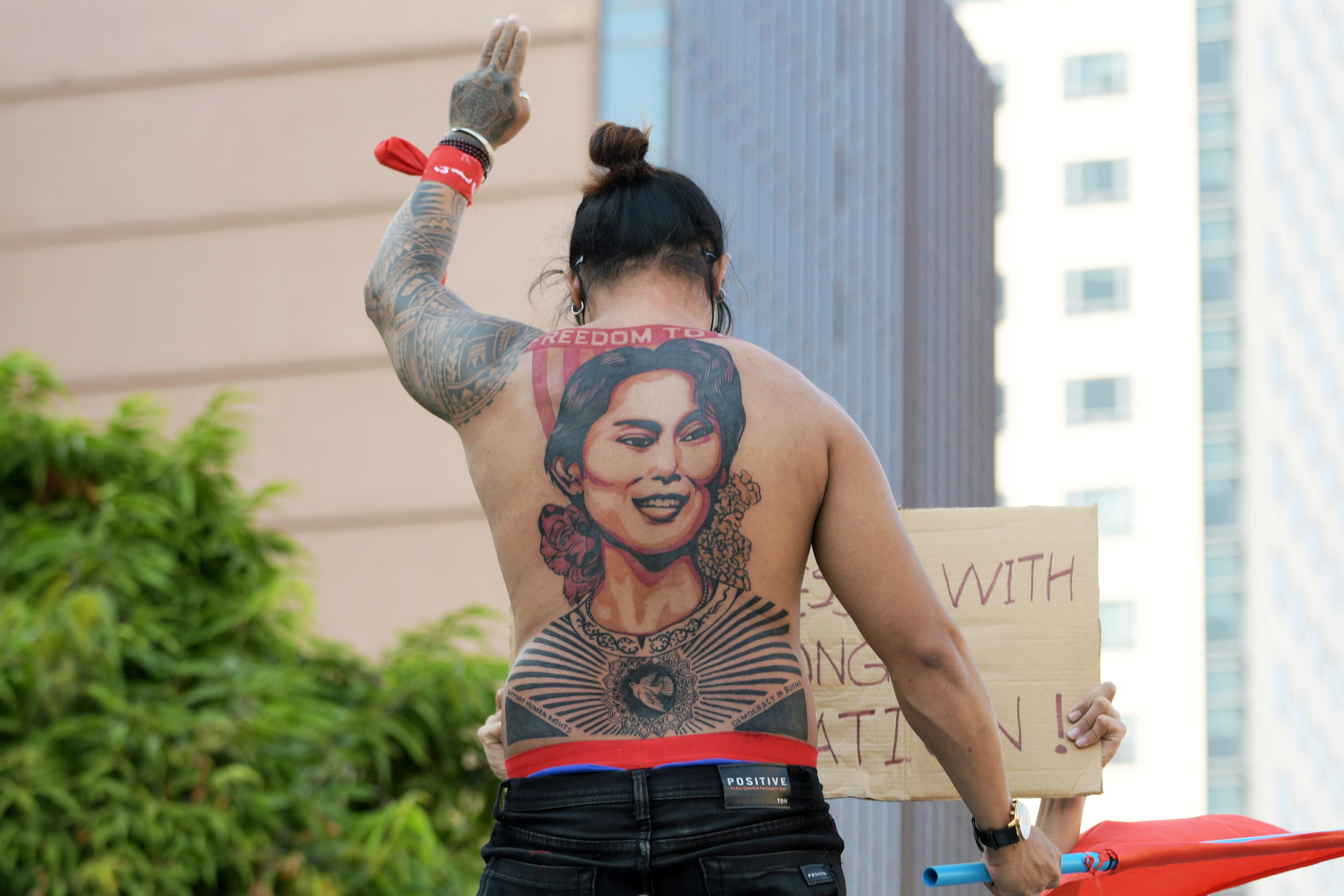 A man with a tattoo of Aung San Suu Kyi takes part in a protest against the military coup and to demand the release of the elected leader in Yangon, Myanmar, February 8, 2021.