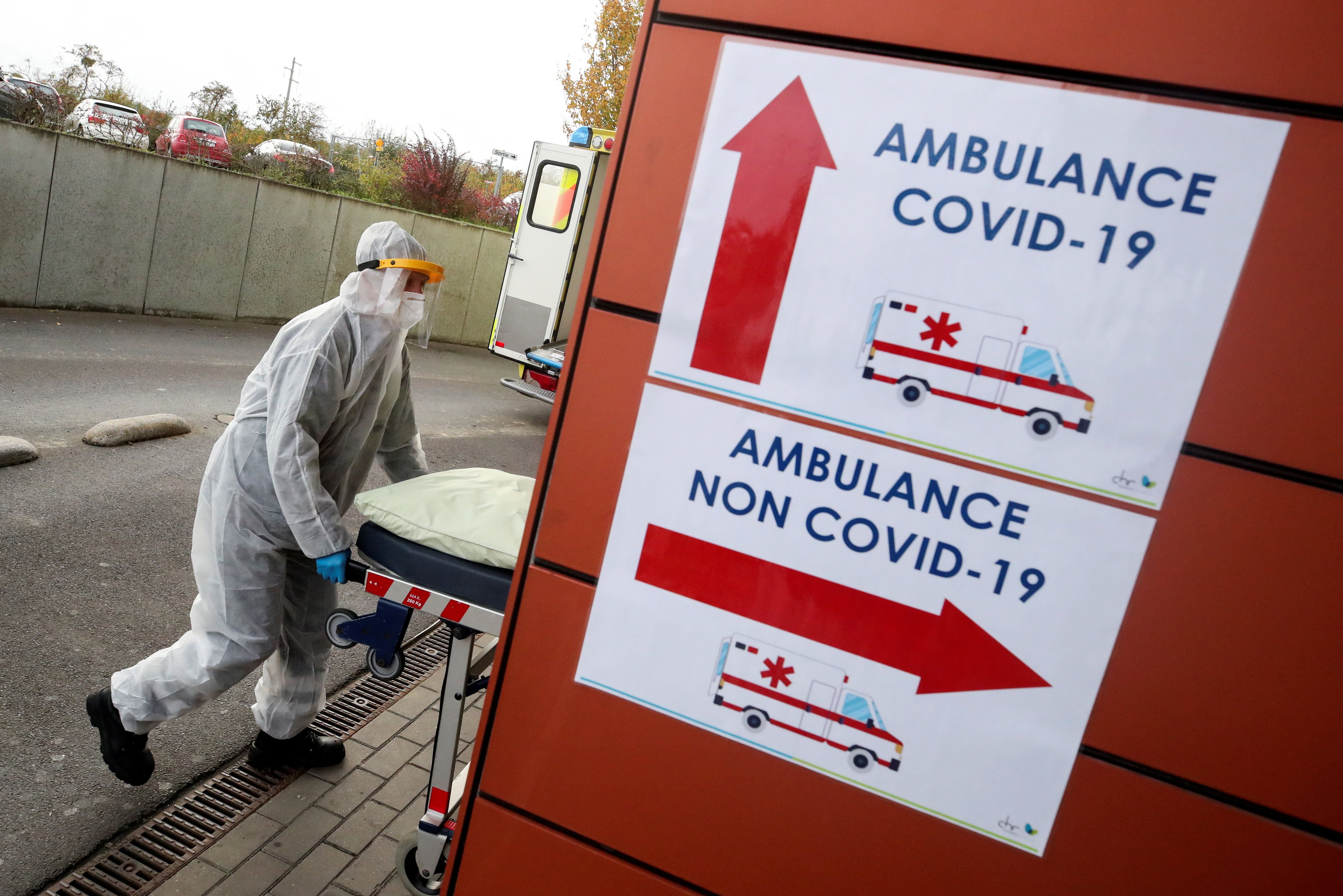 A member of the medical personnel wearing personal protective equipment (PPE) pushes a stretcher outside the CHR Sambre-Meuse hospital, amid the coronavirus disease (COVID-19) outbreak, in Auvelais, Belgium October 28, 2020