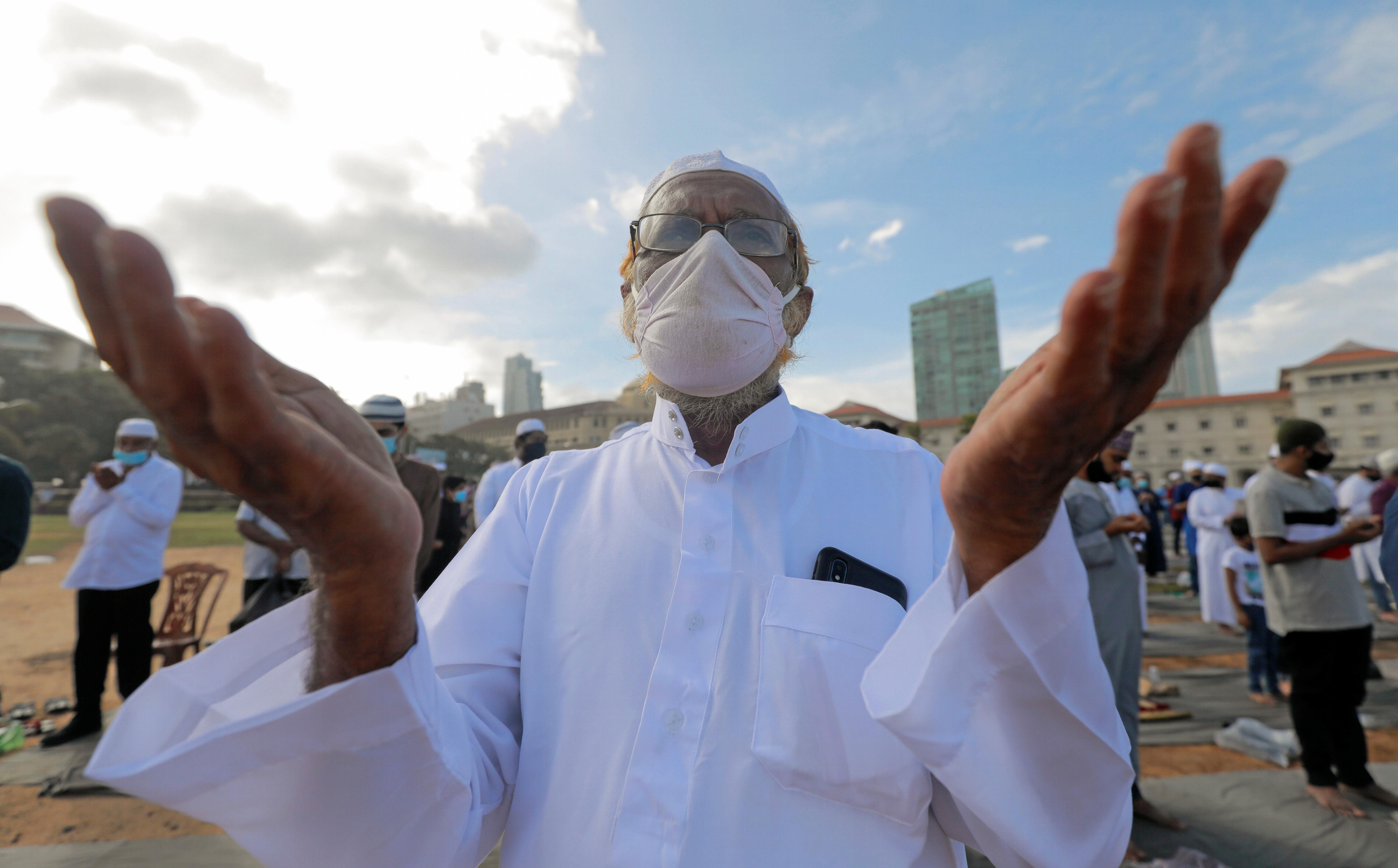 A Muslim man wearing a protective mask practice social distancing as he attends a prayer to mark the Hajj festival, amid concerns about the spread of the coronavirus disease (COVID-19), in Colombo, Sri Lanka, August 1, 2020.
