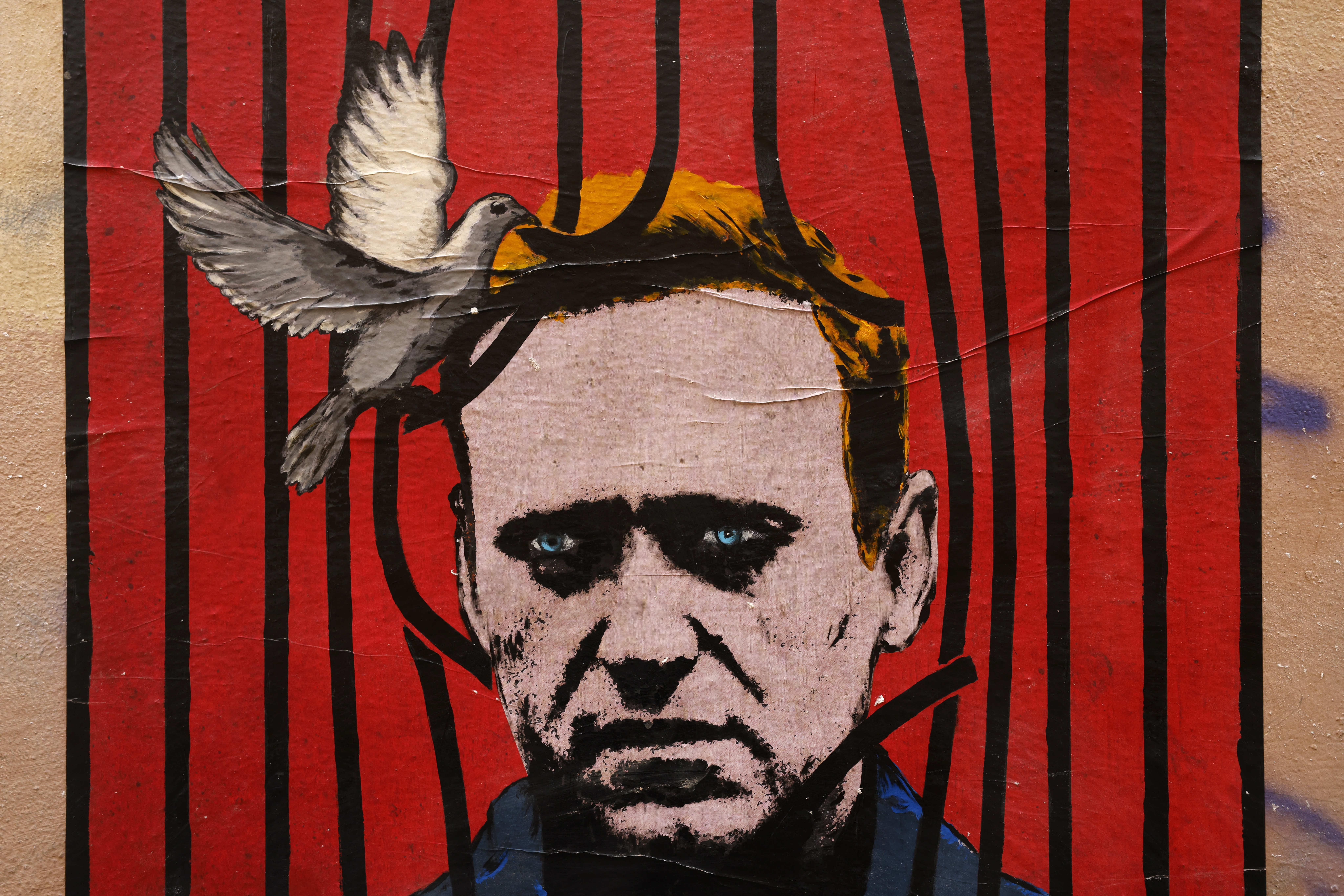 A poster by street artist Harry Greb depicting Russian opposition leader Alexey Navalny in Rome. Reuters