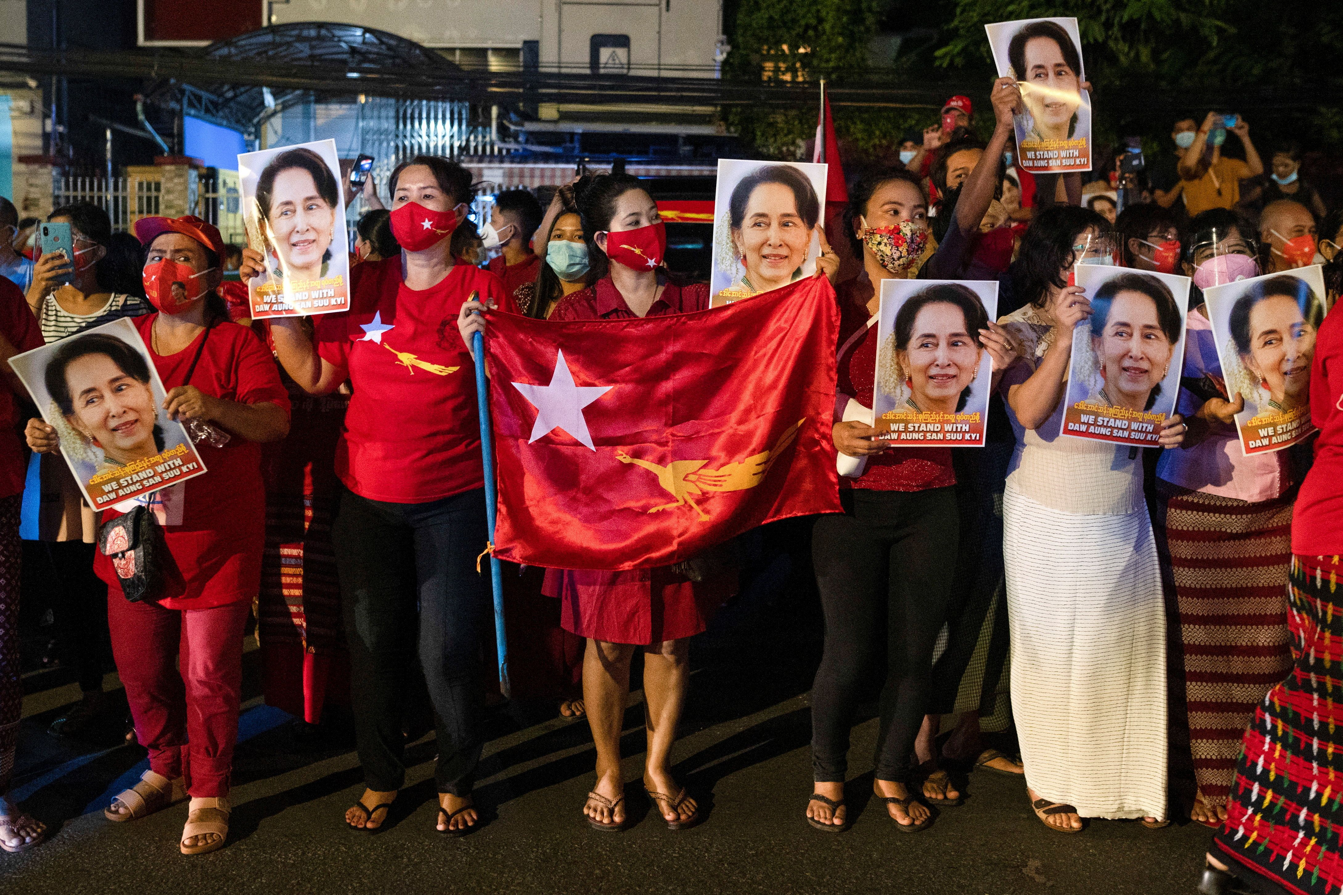 A supporter of National League for Democracy gather to celebrate at party headquarters after the general election in Yangon, Myanmar
