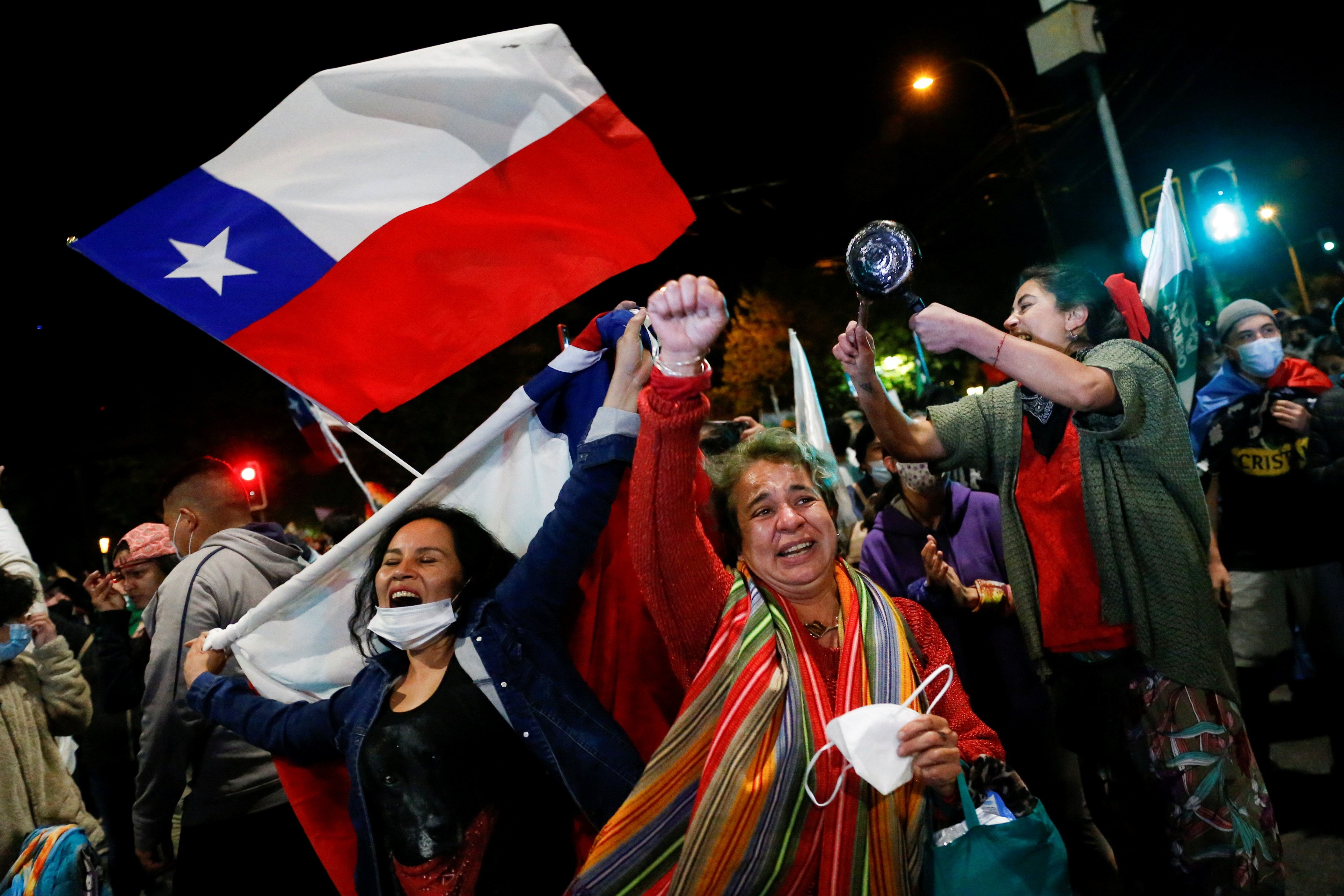 """A """"yes"""" supporter reacts to the result of Chile's national referendum on a new constitution in Valparaíso. Reuters"""