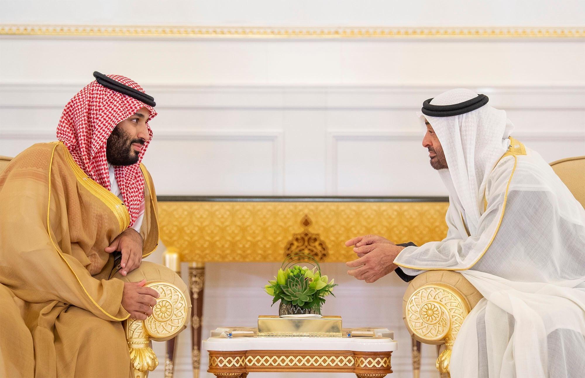 Abu Dhabi's Crown Prince Sheikh Mohammed bin Zayed al-Nahyan talks with Saudi Arabia's Crown Prince Mohammed bin Salman Al Saud in Abu Dhabi, UAE, November 22, 2018.