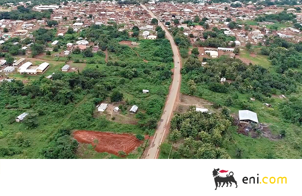 Aerial view of a rural area with trees and a winding road in Ghana.