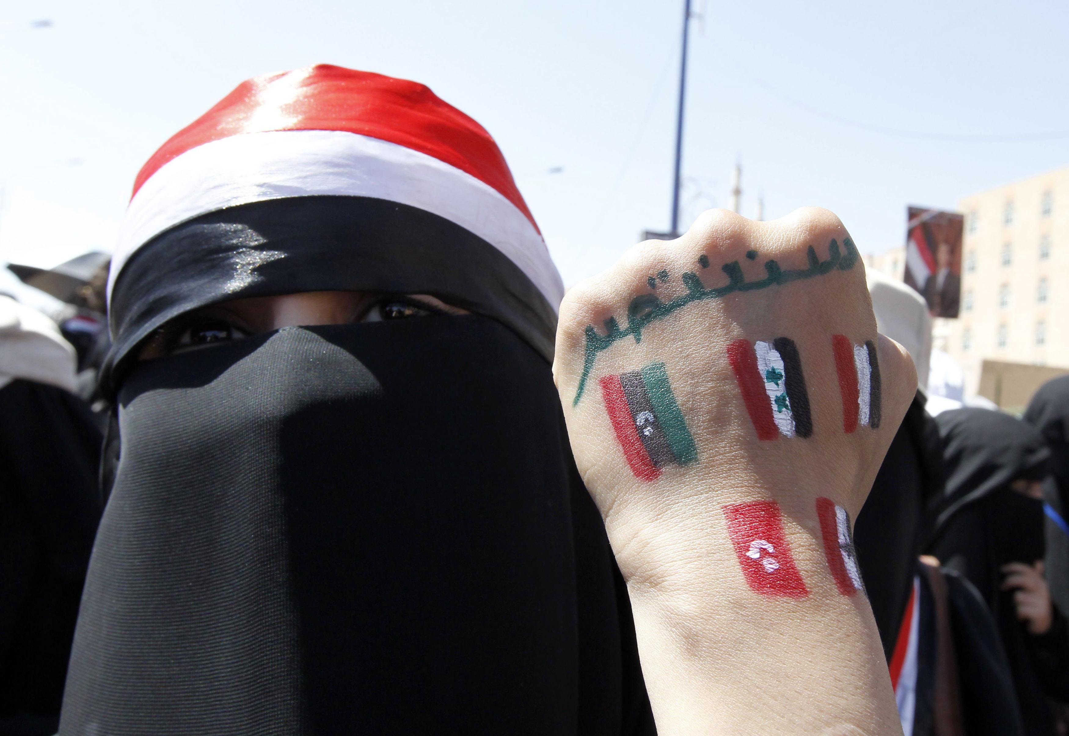 An anti-government protester displays paintings on her hand in Sanaa, Yemen, during the Arab Spring marches in 2011. Reuters