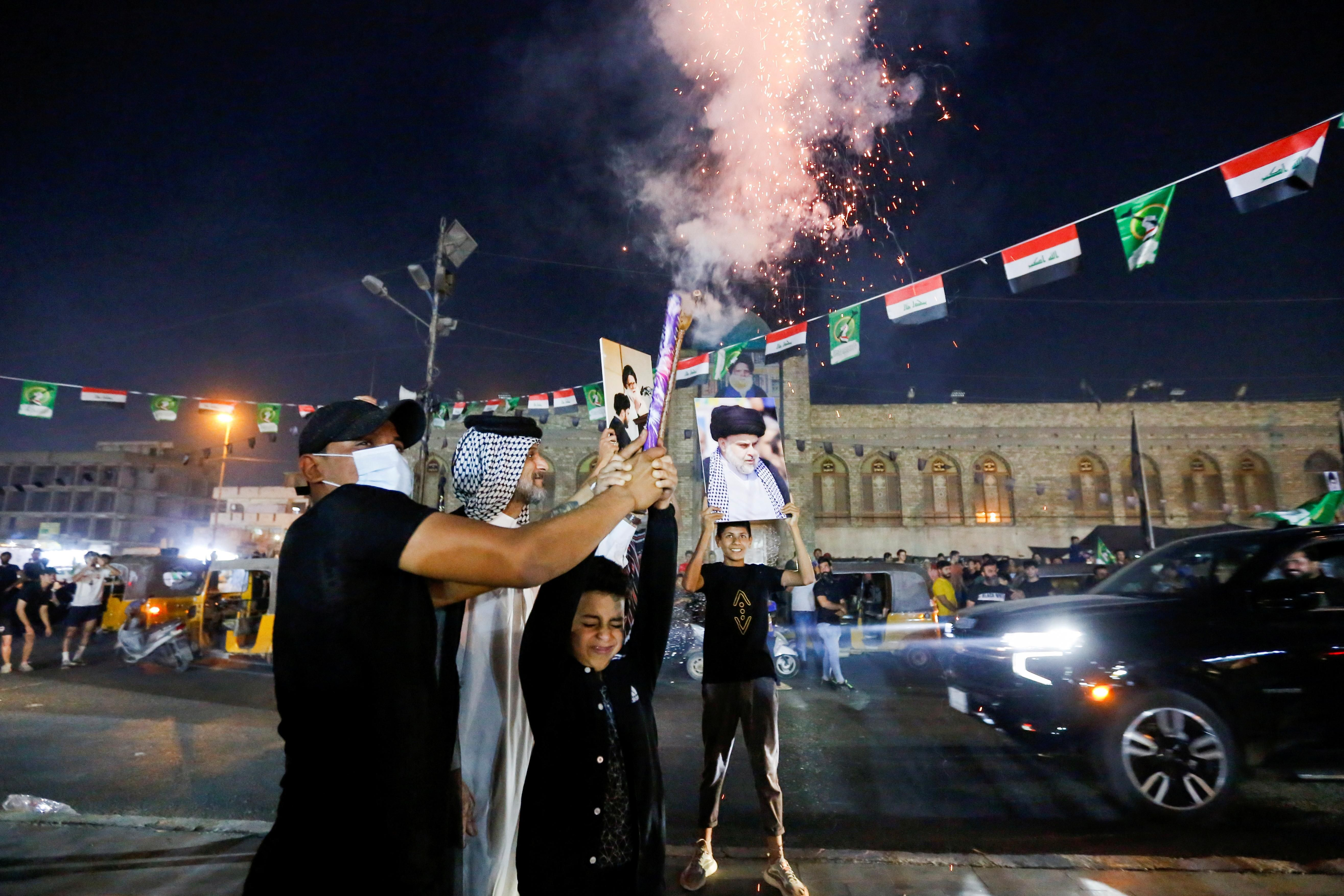 announced, in Sadr City, in Baghdad People celebrate on the street after preliminary results of Iraq's parliamentary election were announced, in Sadr City, in Baghdad, Iraq October 11, 2021