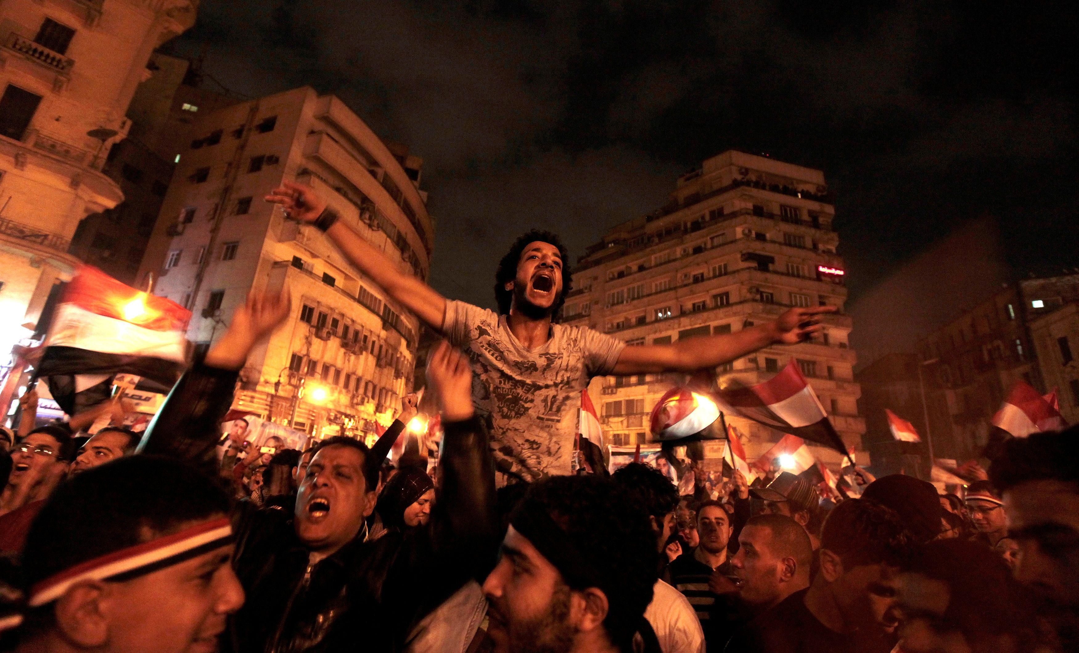 Anti-government protesters celebrate inside Tahrir Square after the announcement of Egyptian President Hosni Mubarak's resignation in Cairo, Egypt, February 11, 2011.