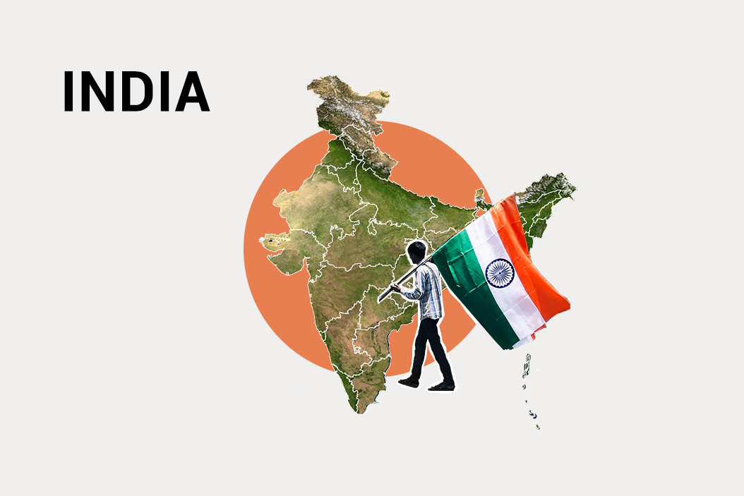 Art of man carrying the Indian flag in front of a map of India