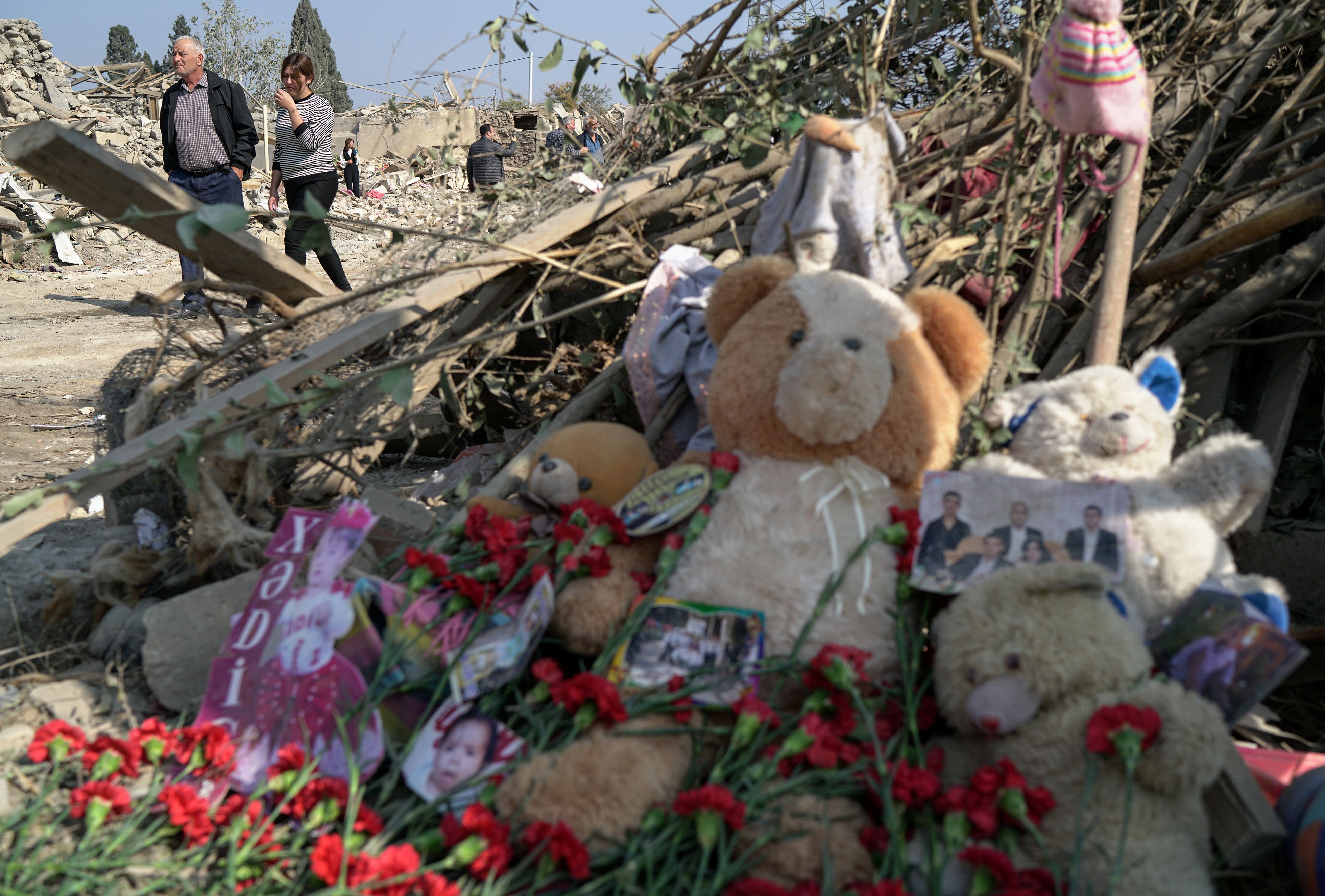Carnations, teddy bears and pictures are laid to the blast site hit by a rocket attack in the city of Ganja, Azerbaijan. Reuters