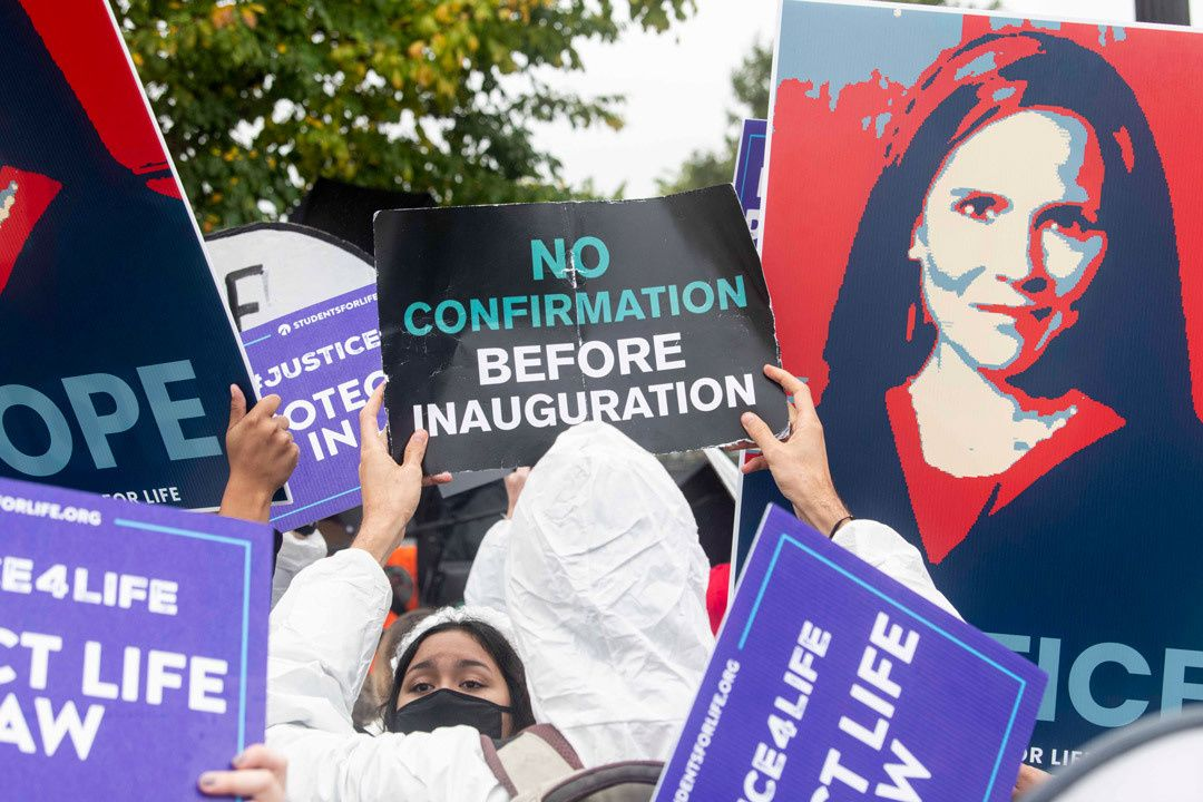 Demonstrators for and against President Trump's Supreme Court nominee Amy Coney Barrett gather outside the US Supreme Court on the first day of Senate confirmation hearings