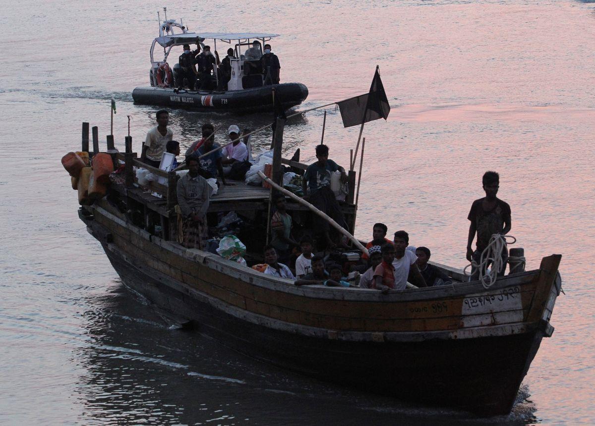 Hard Numbers: Malaysia detains Rohingya, US polling on Floyd killing, COVID cases hit 7 million