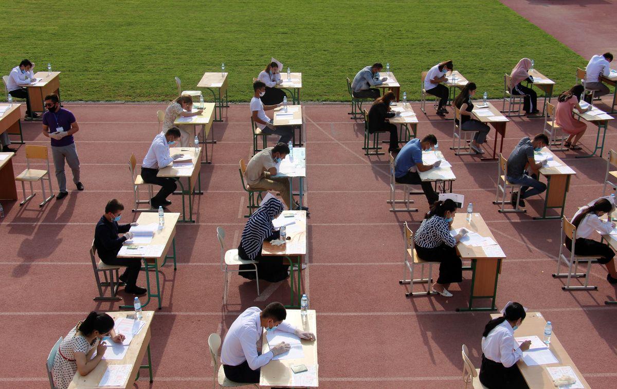 High school graduates take university entrance exams at a sports arena amid the pandemic in Tashkent, Uzbekistan.