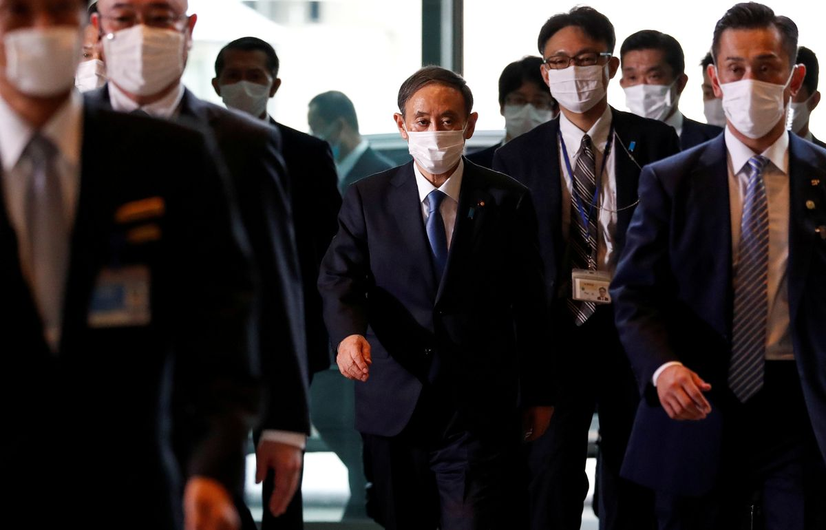 Japan's newly-elected Prime Minister Yoshihide Suga arrives at his official residence in Tokyo