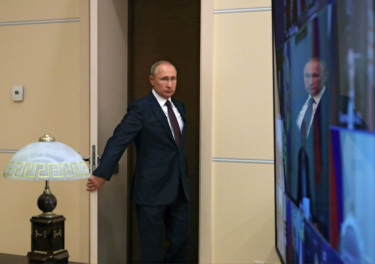 Russian President Vladimir Putin arrives for a meeting with members of the Security Council via a video link at the Novo-Ogaryovo state residence outside Moscow, Russia September 4, 2020.