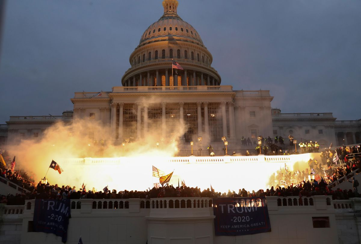 An explosion caused by a police munition is seen while supporters of U.S. President Donald Trump gather in front of the U.S. Capitol Building in Washington, U.S., January 6, 2021