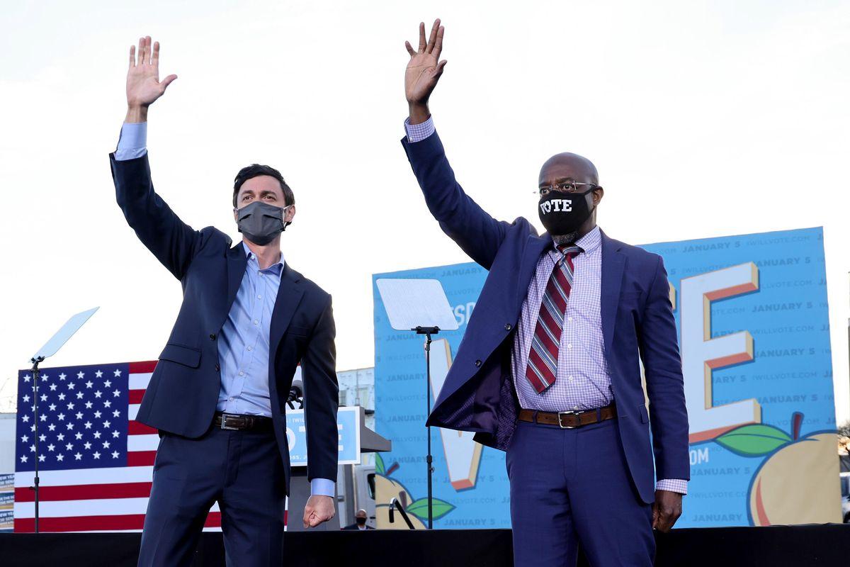 US senators-elect Jon Ossoff and Raphael Warnock campaign at a rally ahead of runoff elections in Atlanta, Georgia. Reuters