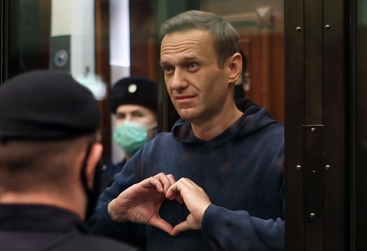 MOSCOW, RUSSIA - FEBRUARY 2, 2021: Russian opposition activist Alexei Navalny makes a heart gesture during a hearing into an application by the Russian Federal Penitentiary Service to convert his suspended sentence of three and a half years in the Yves Rocher case into a real jail term