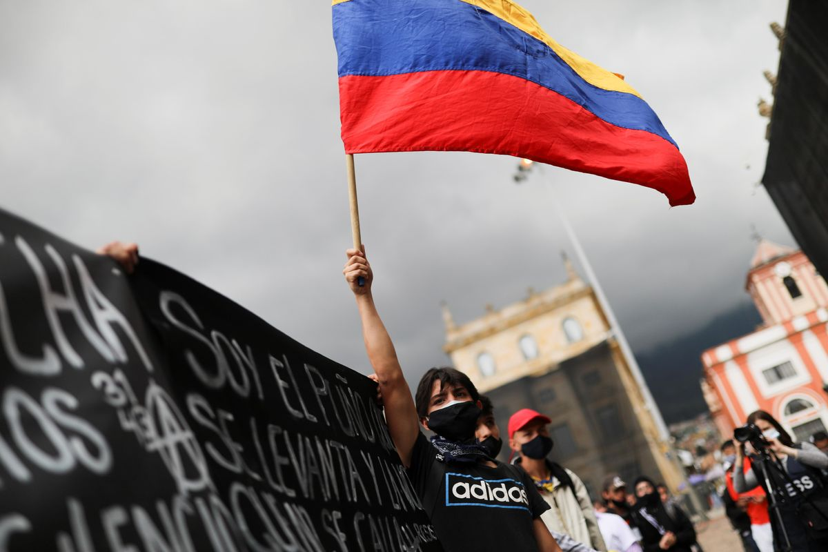A demonstrator holds a flag during a protest against the tax reform of President Ivan Duque's government in Bogota, Colombia, April 29, 2021.