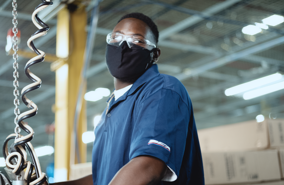 A factory worker. Walmart commits $350 billion to support American jobs