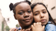 Two girls hugging -  A $1.25B investment in advancing equality and economic opportunity