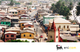 View of a street lined with colorful buildings in Ghana