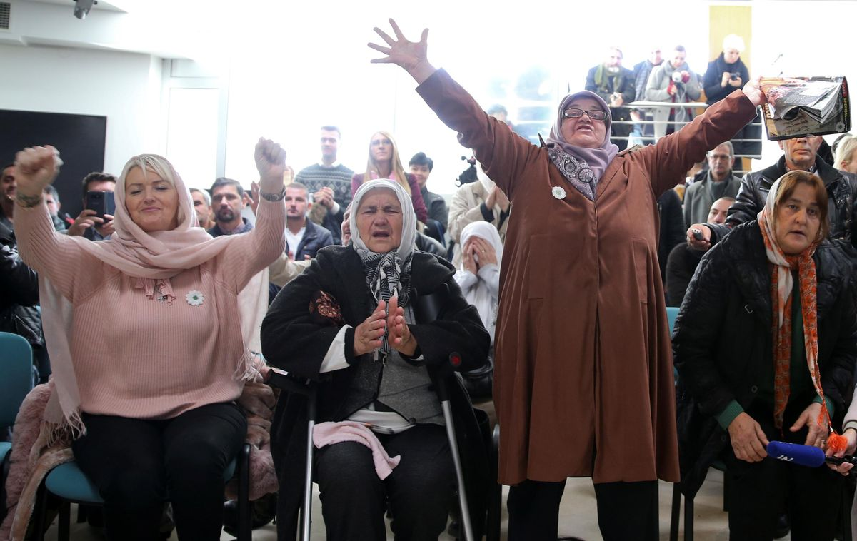 Women react as they watch a television broadcast of the court proceedings of former Bosnian Serb general Ratko Mladic in the Memorial centre Potocari near Srebrenica, Bosnia and Herzegovina, November 22, 2017.