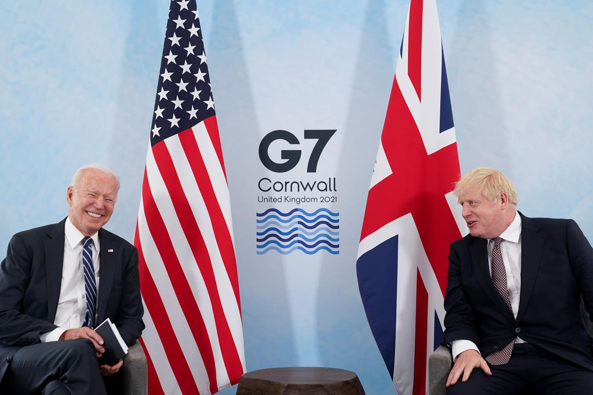 U.S. President Joe Biden laughs while speaking with Britain's Prime Minister Boris Johnson during their meeting, ahead of the G7 summit, at Carbis Bay, Cornwall, Britain June 10, 2021