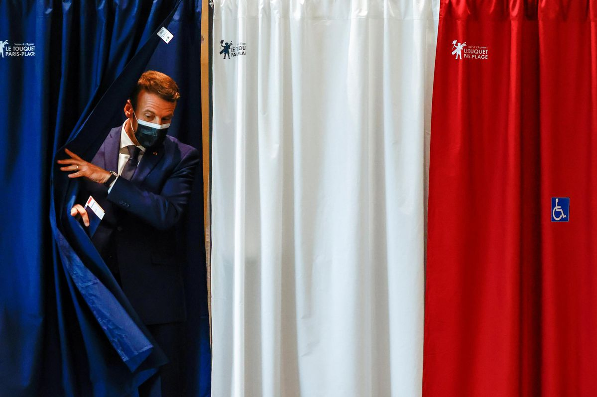 French President Emmanuel Macron is seen at a polling station during the first round of French regional and departmental elections, in Le Touquet-Paris-Plage, France June 20, 2021.