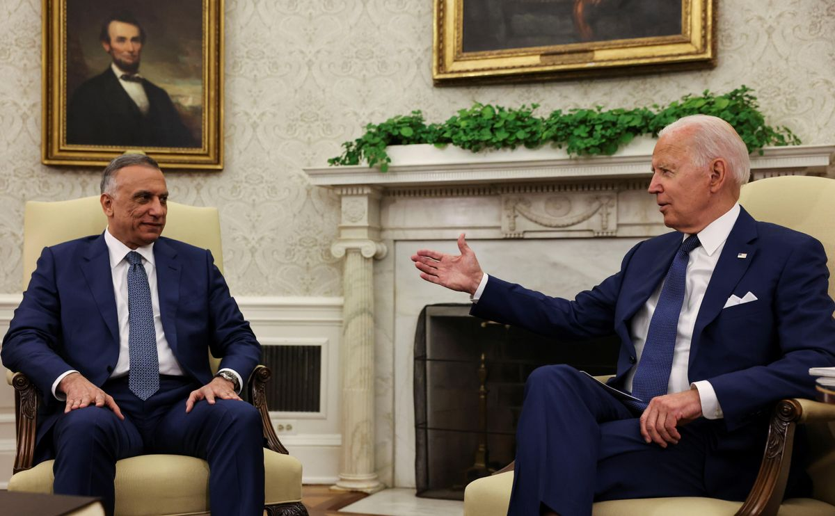 U.S. President Joe Biden SPEAKS with Iraq's Prime Minister Mustafa Al-Kadhimi during a bilateral meeting in the Oval Office at the White House in Washington, U.S., July 26, 2021.