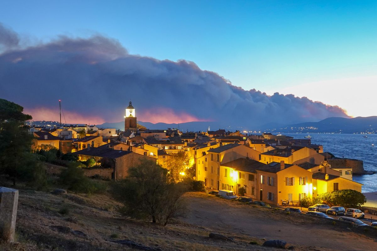 Smoke rises from a massive wildfire in Gonfaron, seen from the heighys of Saint Tropez, south of France on August 16, 2021.