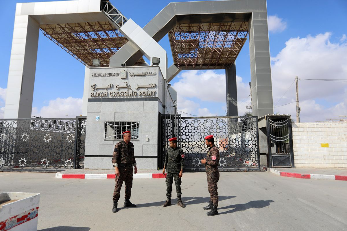 Members of Palestinan security forces stand guard at the closed off Rafah border crossing to Egypt in the southern Gaza Strip, on August 23, 2021