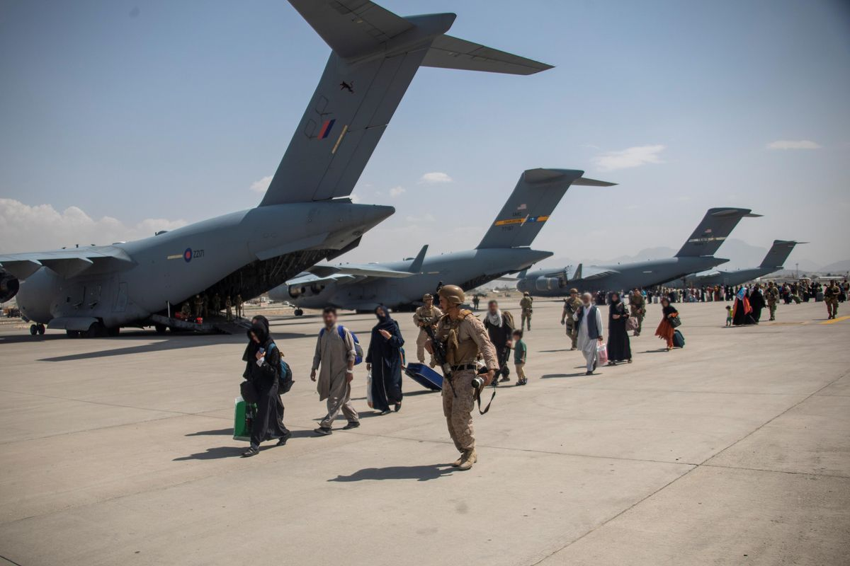 Members of the UK Armed Forces continue to take part in the evacuation of entitled personnel from Kabul airport, in Kabul, Afghanistan August 19-22, 2021, in this handout picture obtained by Reuters on August 23, 2021.
