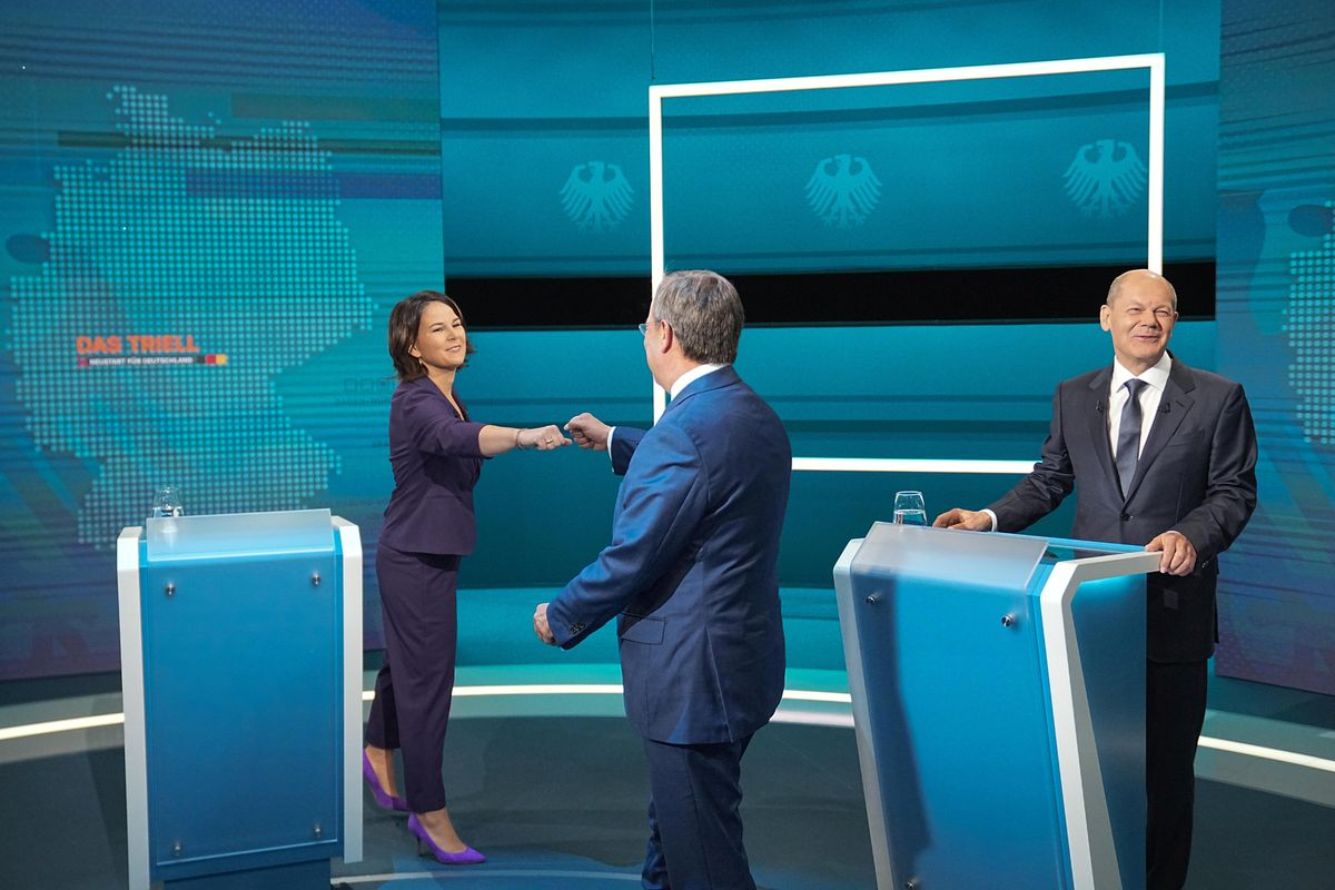 hairwoman of Buendnis 90/Die Gruenen Annalena Baerbock is greeted by Prime Minister of North Rhine-Westphalia (NRW) and leader of the Christian Democratic Union (CDU) Armin Laschet as German Finance Minister and Social Democratic Party candidate Olaf Scholz looks on before the start of a televised debate of the candidates to succeed Angela Merkel as German chancellor in Berlin, Germany, August 29, 2021