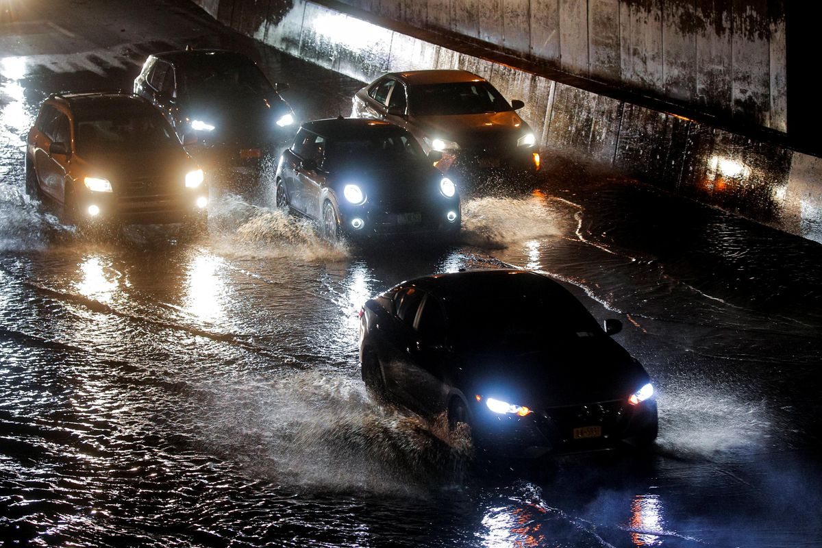 Cars navigate a flooded highway, as local media reported the remnants of Tropical Storm Ida bringing drenching rain and the threat of flash floods and tornadoes to parts of the northern mid-Atlantic, in the Queens borough of New York City, U.S., September 2, 2021.