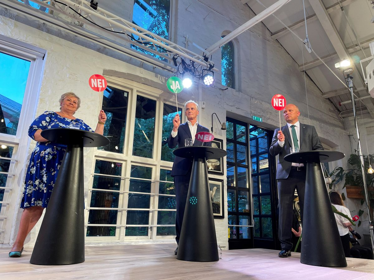 The three candidates for Norway's prime minister Erna Solberg from the Conservatives, Jonas Gahr Stoere from Labour Party and Trygve Slagsvold Vedum from the Centre Party attend a debate in central Oslo, Norway August 9, 2021