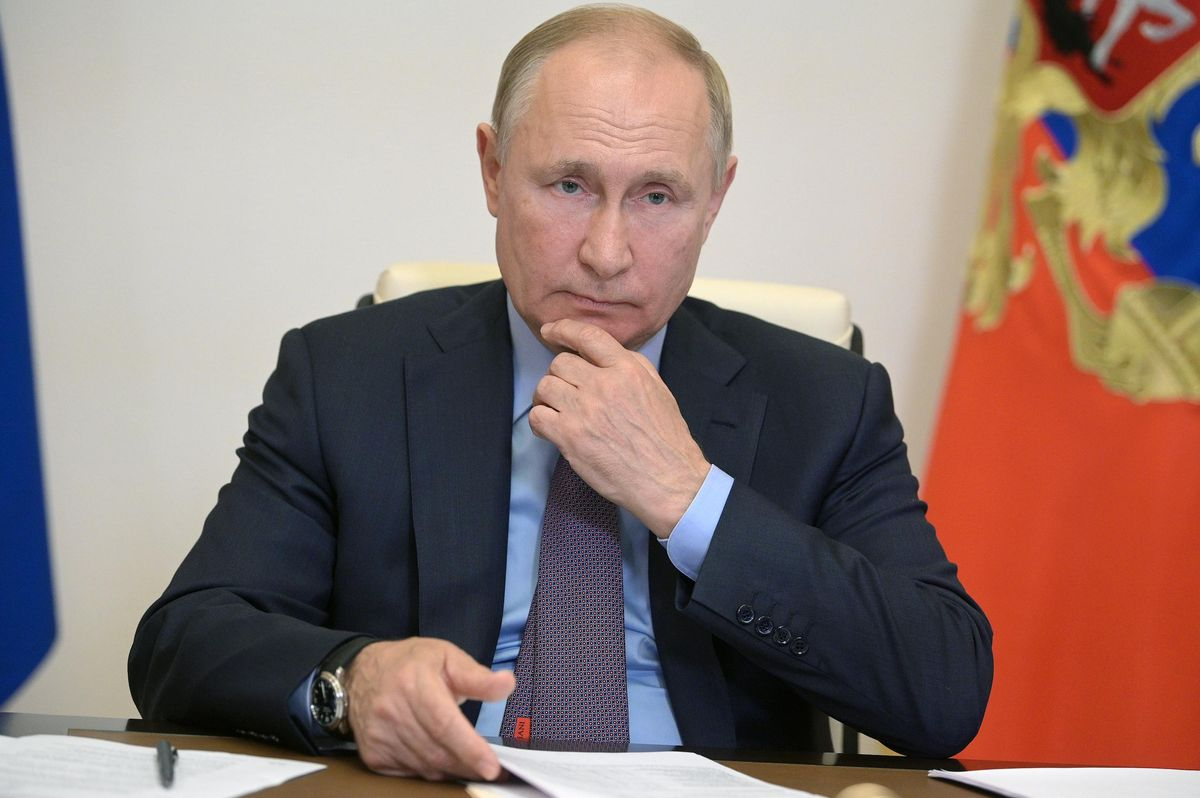 Russia's President Vladimir Putin is seen in his office in the Novo-Ogaryovo residence during a videoconference meeting