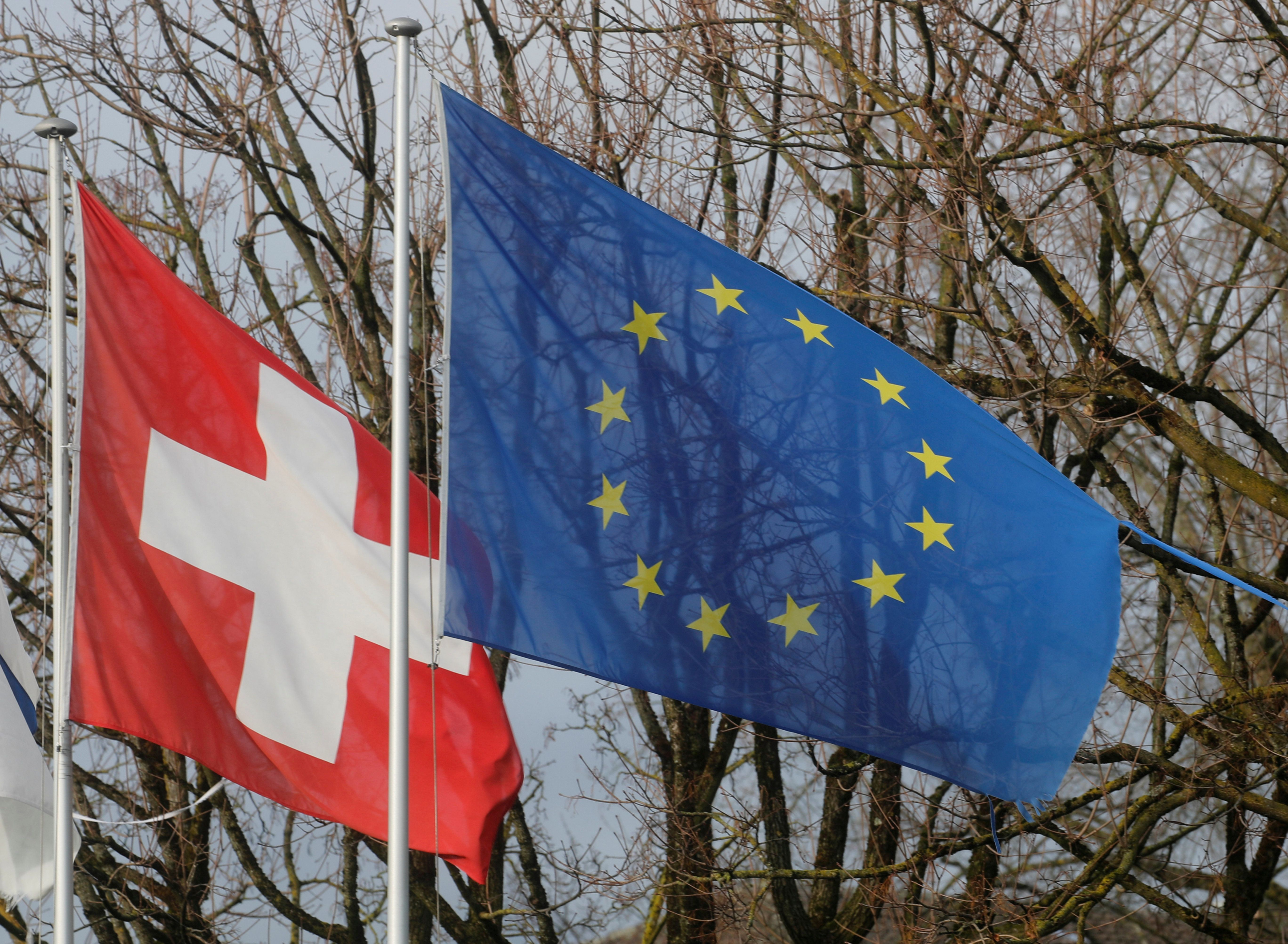 File photo of Swiss and EU flags. Reuters