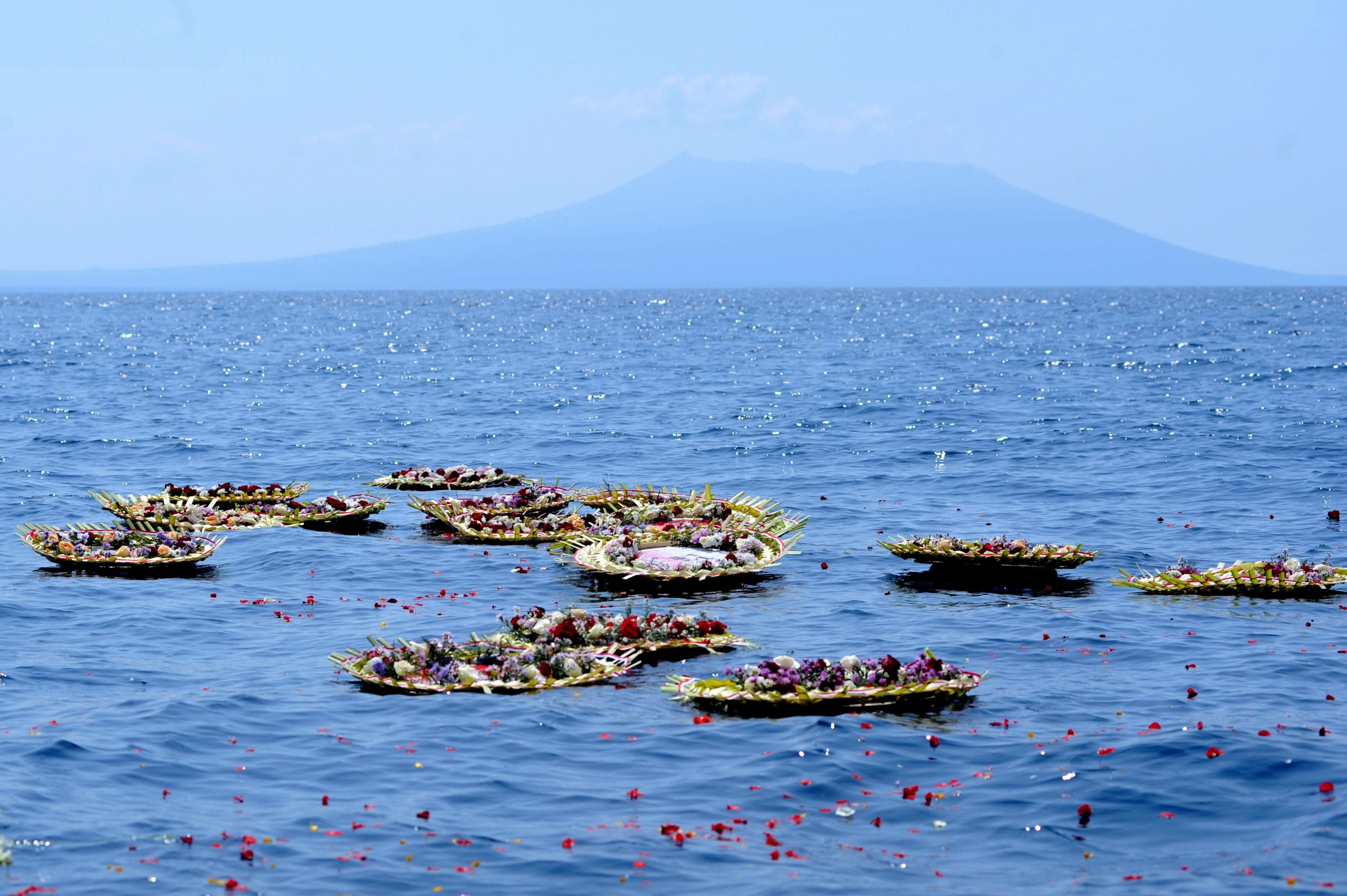 Flowers and petals with names of the sunken KRI Nanggala-402 submarine crew members are seen at the sea near Labuhan Lalang, Bali, Indonesia April 26, 2021