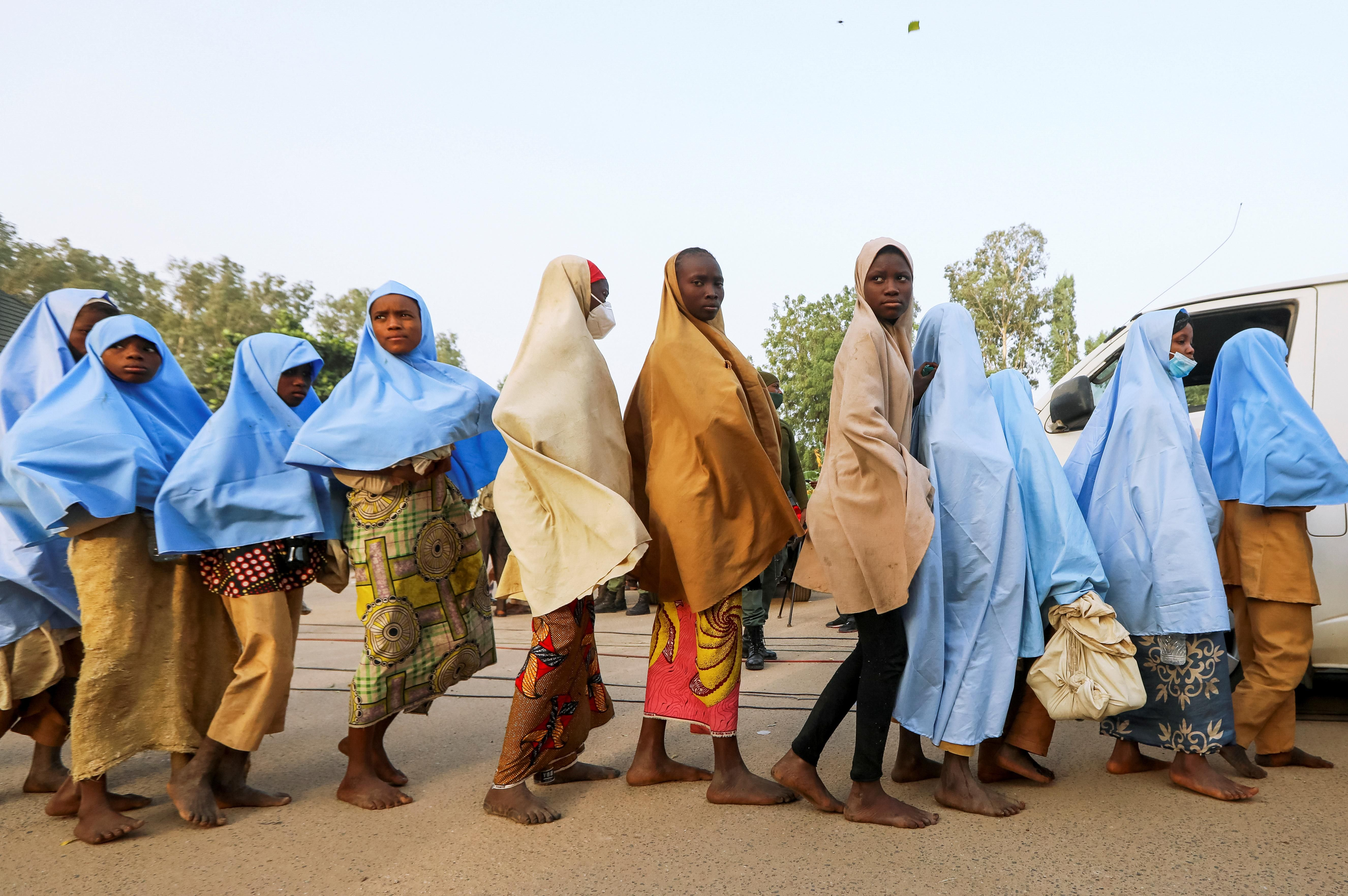 Girls who were kidnapped from a boarding school in the northwest Nigerian state of Zamfara walk in line after their release, in Zamfara, Nigeria March 2, 2021