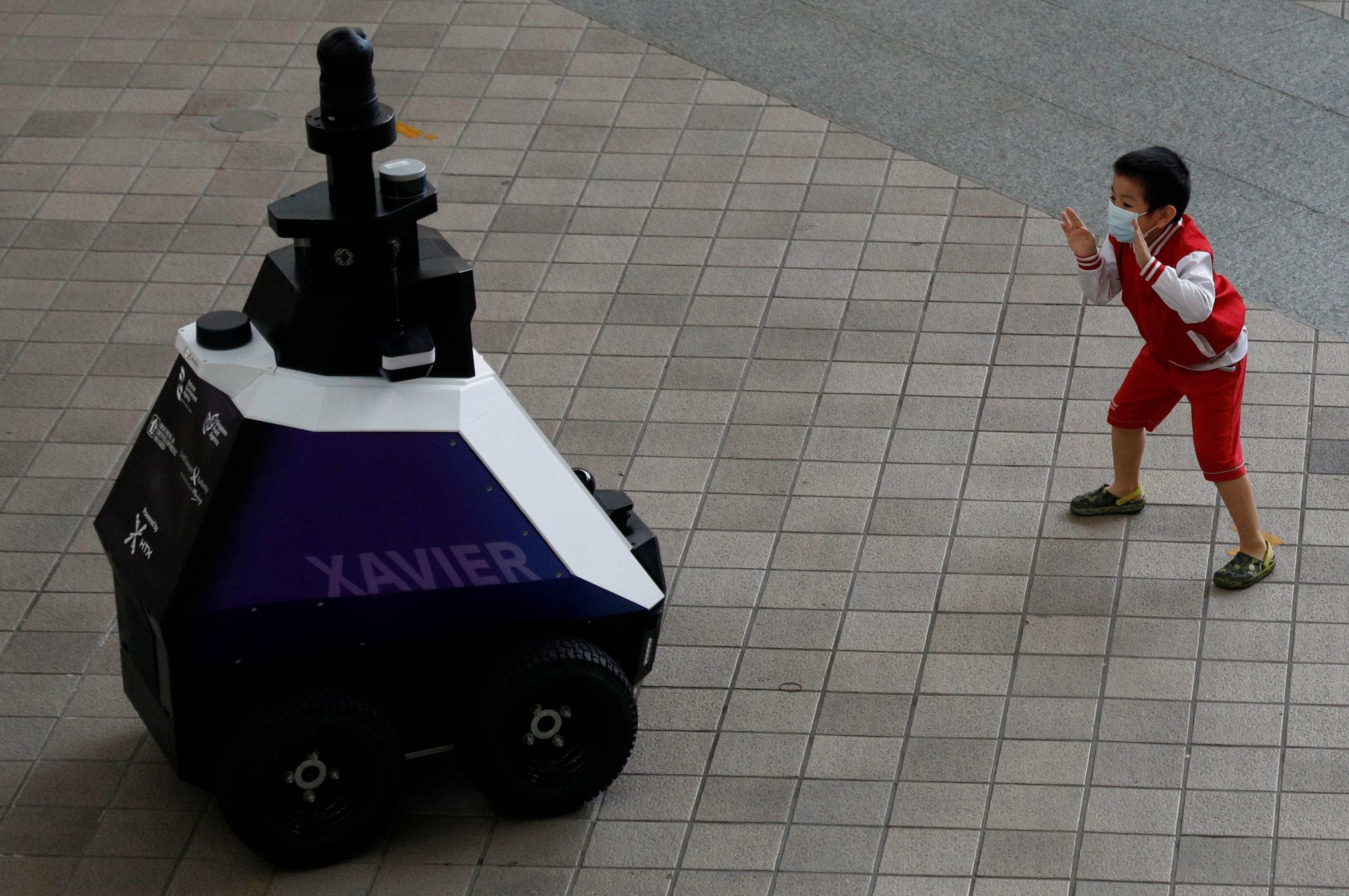 Hard Numbers: Robot cops in Singapore, malaria vaccine arrives, Russian COVID deaths soar, EU slow-walks Balkan hopefuls