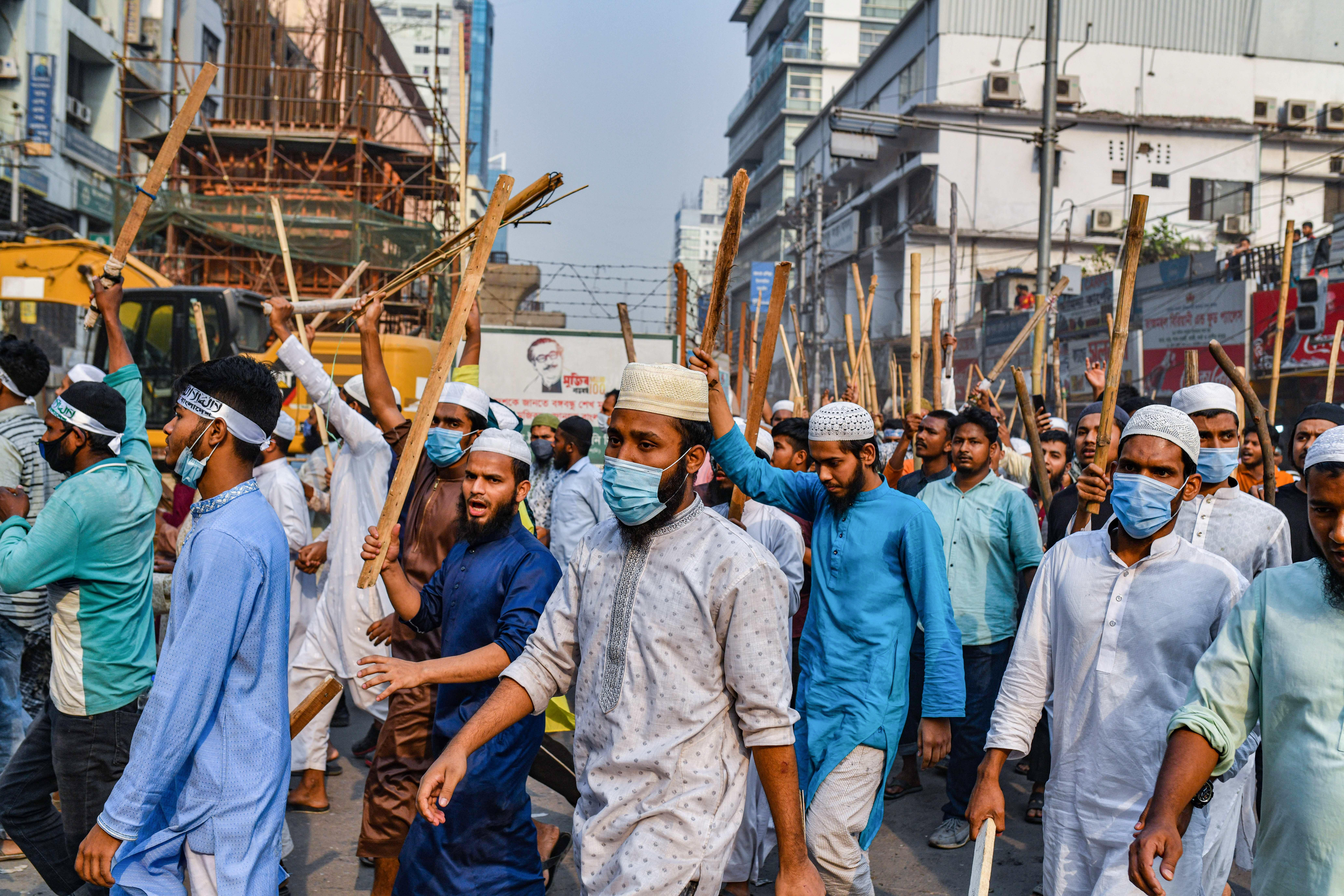 Hefazat-e Islam activists hold sticks while blocking the road during the demonstration. Hefazat-e Islam activists took part during a nationwide strike following the deadly clashes with police over Indian Prime Minister Narendra Modis visit in Dhaka, Bangladesh.