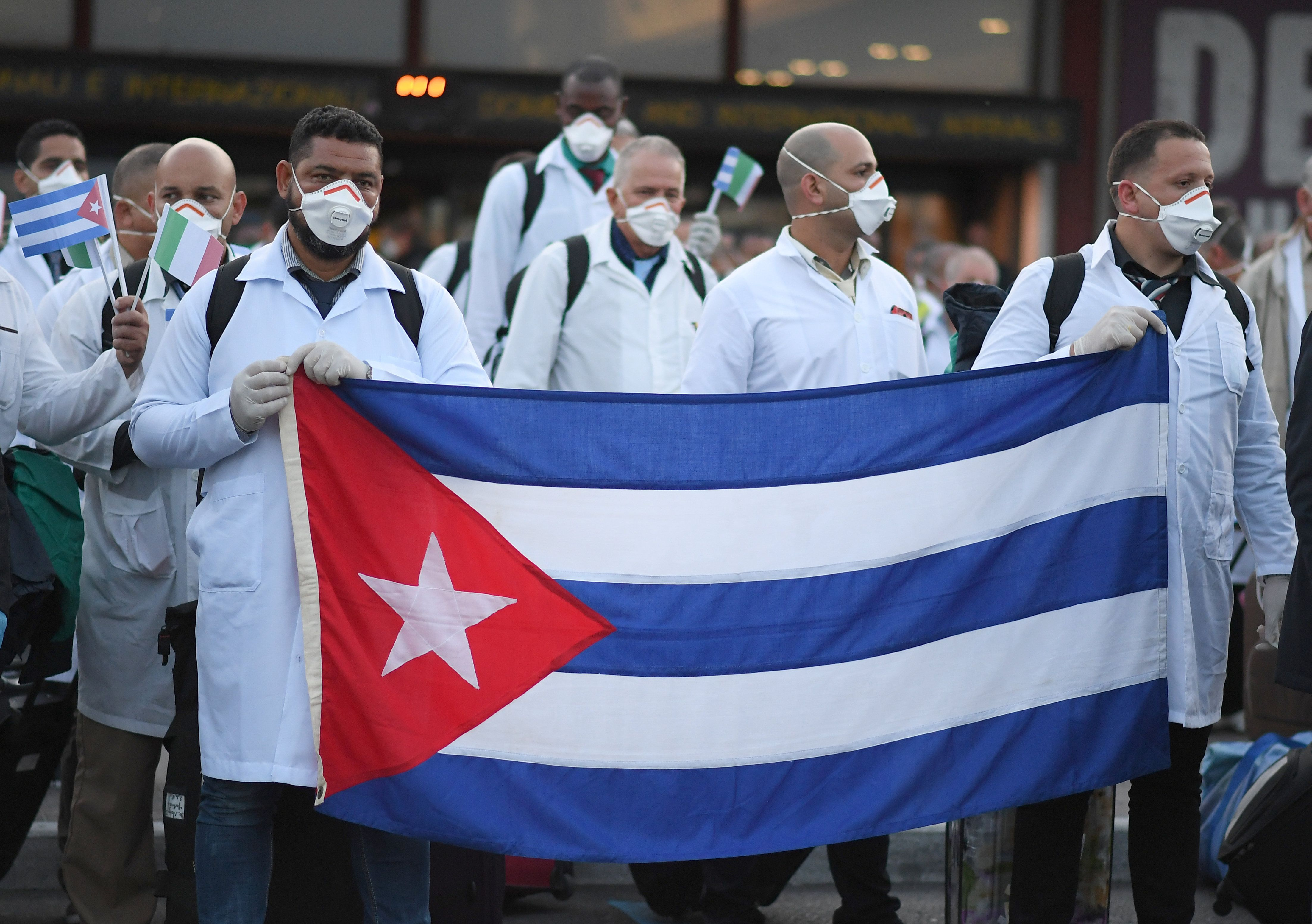 Hard Numbers: Cuban doctors abroad, vaccine promise, China's pressure on the EU, high times in California