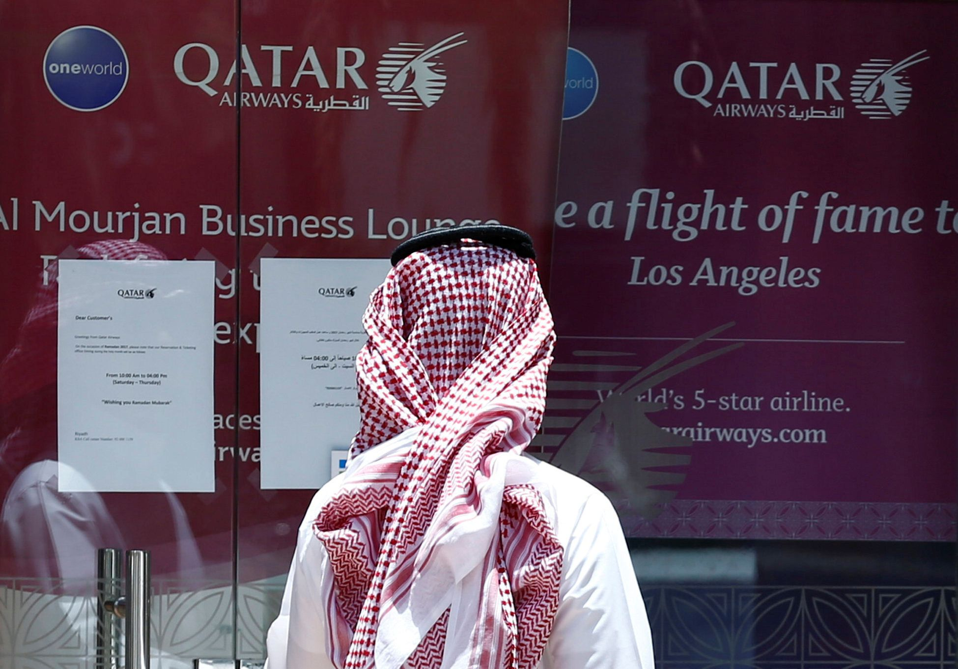 Hard Numbers: Qatar Airways sues, Twitter shuts down QAnon, Rohingyas spared the cane, global development aid falls