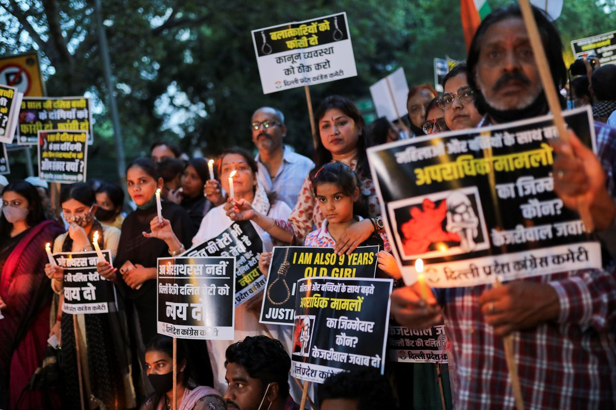 Supporters of India's main opposition Congress party attend a candlelight vigil to protest against the alleged rape and murder of a 9-year-old girl in New Delhi, India, August 4, 2021