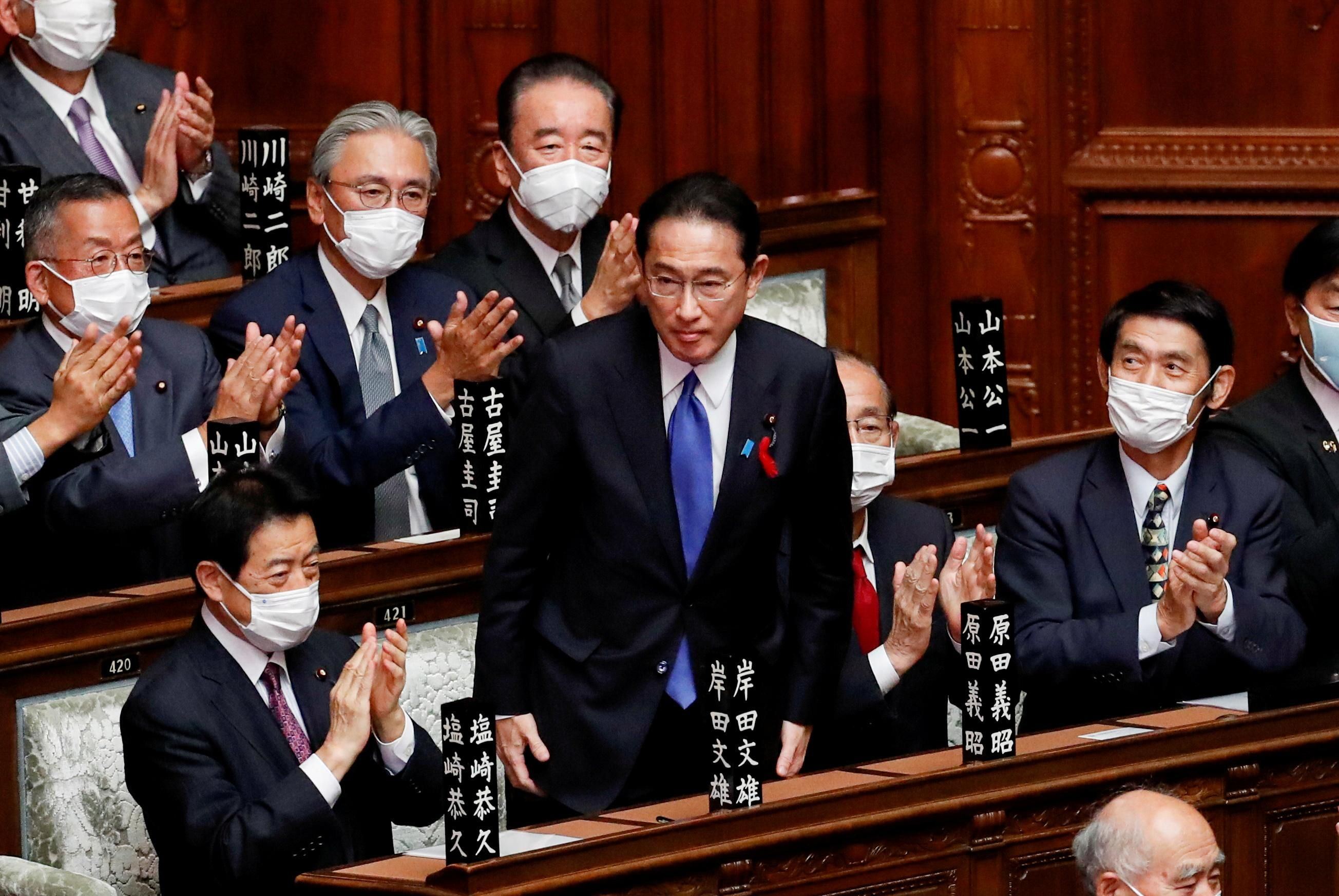Japan's newly-elected Prime Minister Fumio Kishida is applauded after being chosen as the new prime minister, at the Lower House of Parliament in Tokyo, Japan October 4, 2021.