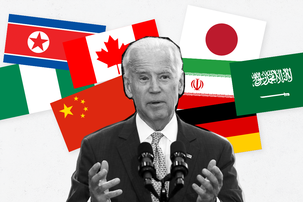 Joe Biden at a speaking lectern surrounded by an array of national flags belonging to Japan, Germany, Iran, China, Nigeria, North Korea, Canada and Saudi Arabia
